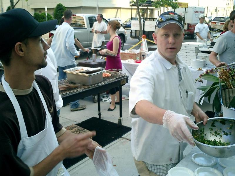 Eric and Ace plating the food