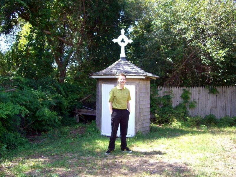3rdarm in front of a Christian cross that looks like the Pagan Zodiac symbol