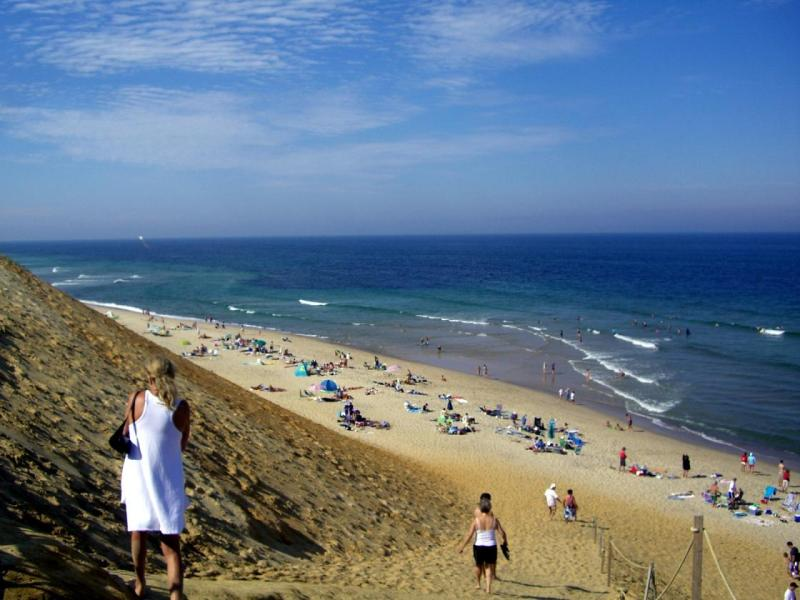Woman in a white dress on the bluff in Wellfleet