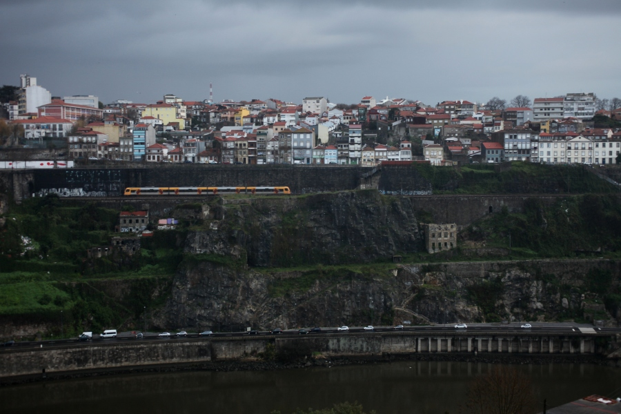 Ponte Infante D. Henrique  bridge douro river gorge porto portugal tile roof historic yellow tramway dawn 3rdarm arthur mullen